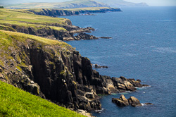 Photograph of Cliffs along Dingle Bay - W27942