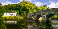 Photograph of Wicklow Clara Bridge and Church - W33516